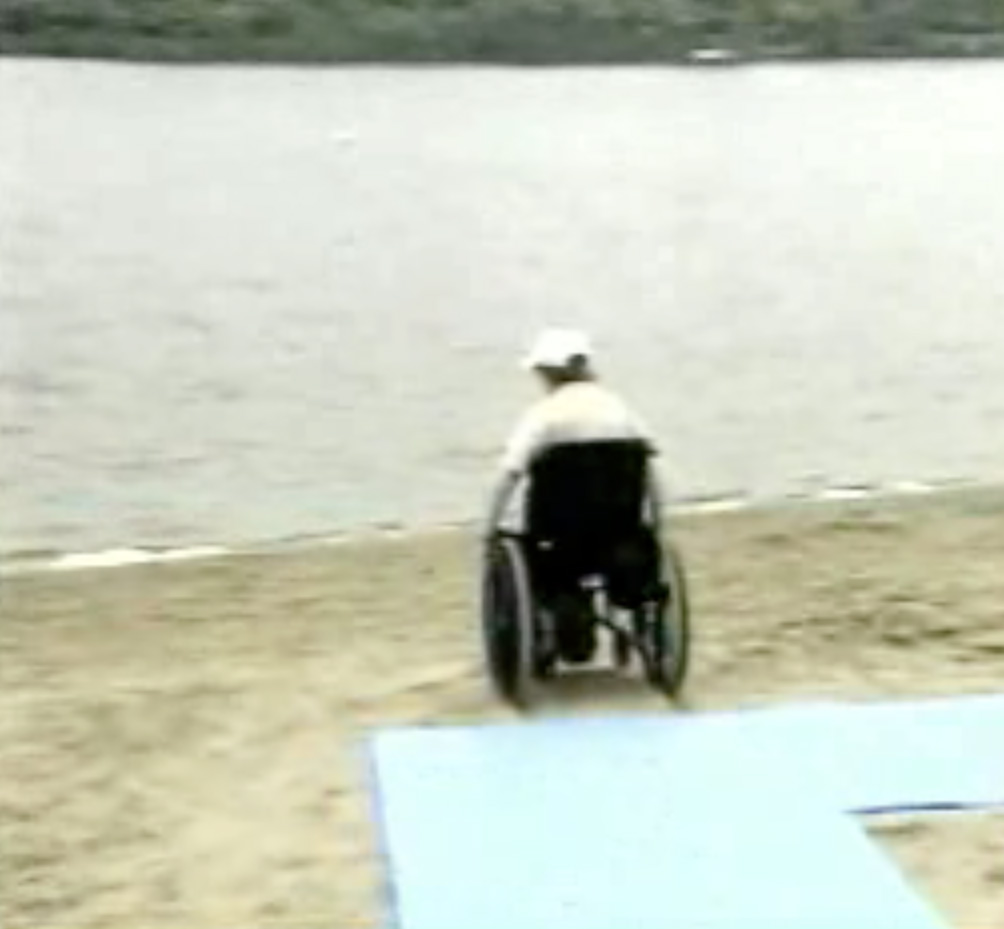 Wheelchair on sand