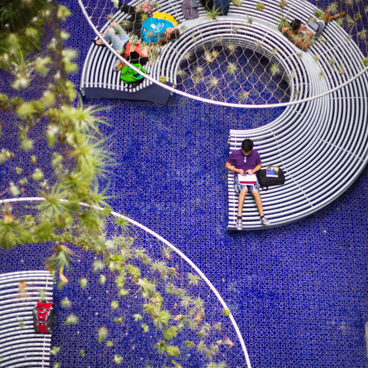 The circular containment rings of Gravelpave2 match the circular elements of the benches and hanging planters.