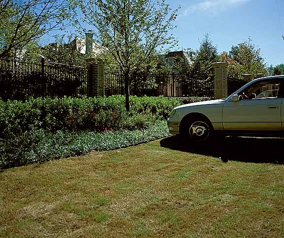 Pervious Pavers were installed in off-street parking areas at a Dallas residence using Grasspave2.