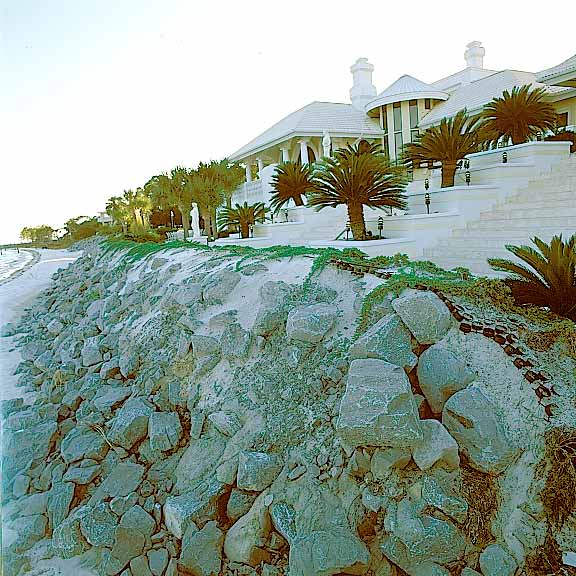Grasspave2 Mats were installed to stabilize the beach wall of a beachfront home using juniper bushes.