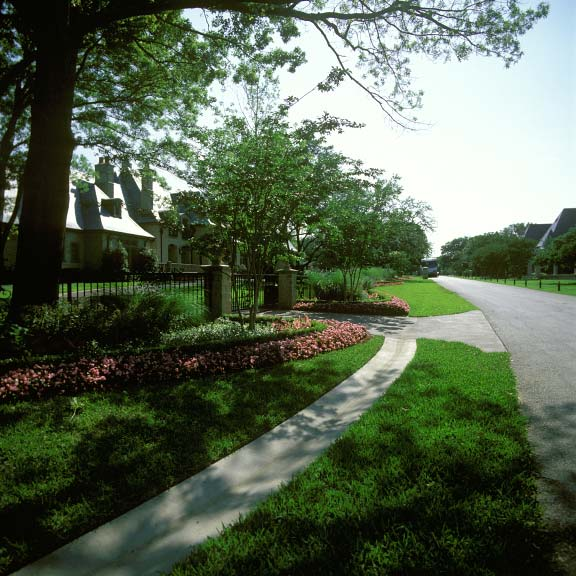 A permeable parking area was installed for off-street parking at the Connor Residence in Dallas, Texas, using Grasspave2.