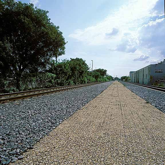 Permeable Paving was installed in the access road at Tri Rail Station at the Miami Airport using Gravelpave2.