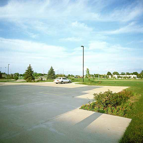 Pervious grass paving was installed in the parking area around the concrete parking lot at the Ankeny Fire Station using Grasspave2.