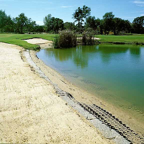 Soil stabilization mats were installed for erosion control around the pond using Slopetame2.