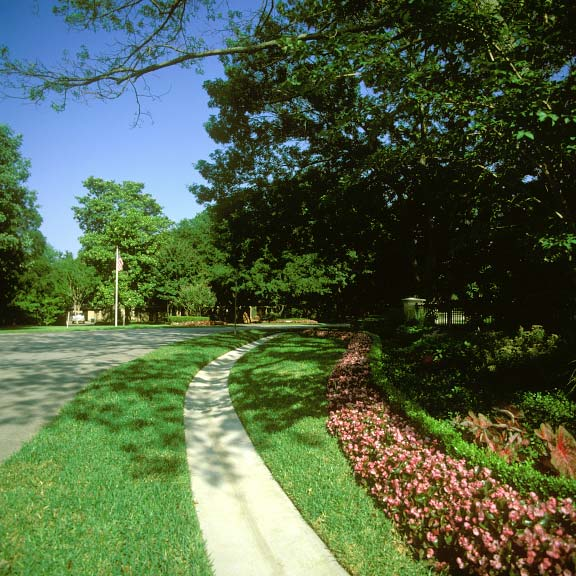 Grass-porous pavement was installed for off-street parking at the Connor Residence in Dallas, Texas, using Grasspave2.
