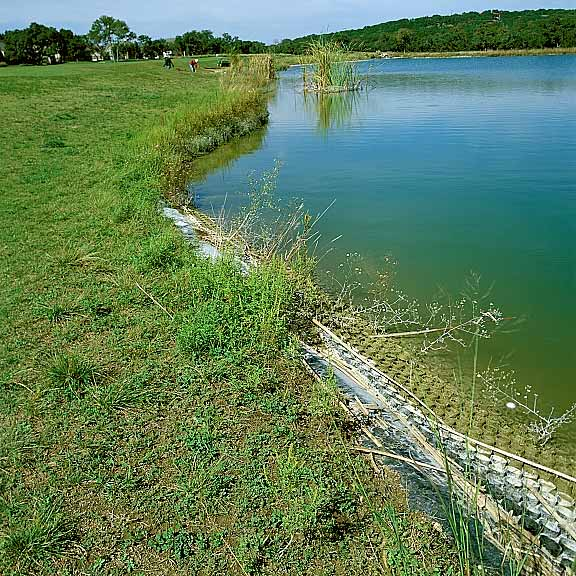Erosion Control was achieved by using Slopetame2 around the edges of the pond.