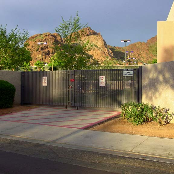 Beyond the fence, Grass-Permeable Paving was installed in the fire lane access areas at Village Racquet And Health Club, Phoenix, Arizona, using Grasspave2.