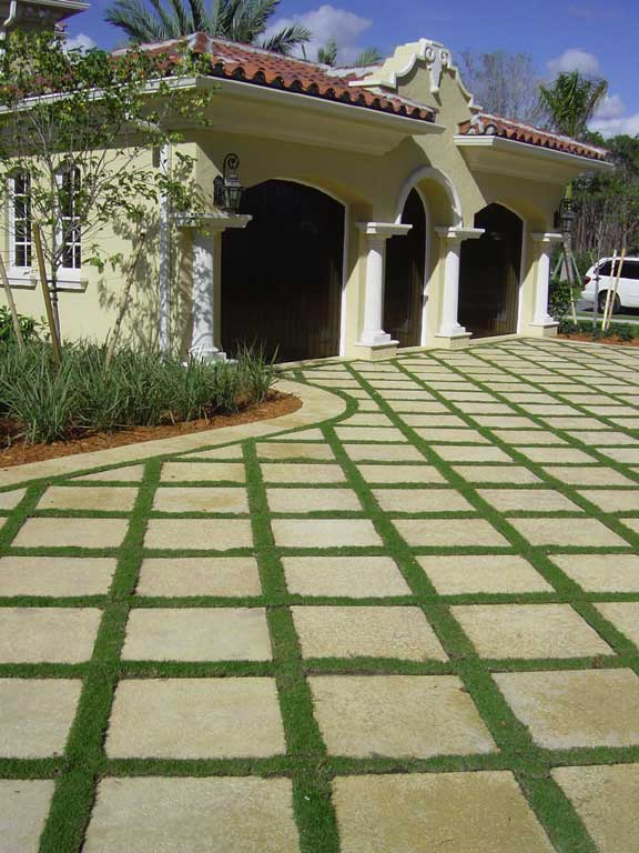 Grass-Paver Drainage Strips were installed under these pavers at the Old Palm Golf Course Residences, Palm Beach, Florida, using Grasspave2.