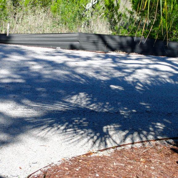 Gravelpave2 pervious pavers meet concrete curbing.