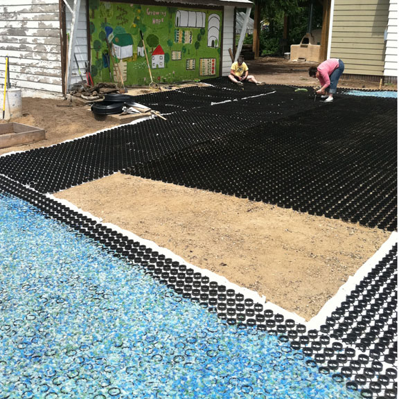 The recycled glass filled Gravelpave2 pathways surrounds the Grasspave2 reinforced patio.
