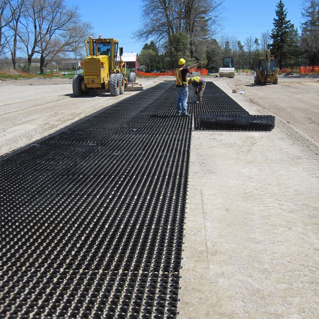 Unrolling the Grasspave2 grass paver ring-and-grid structure.
