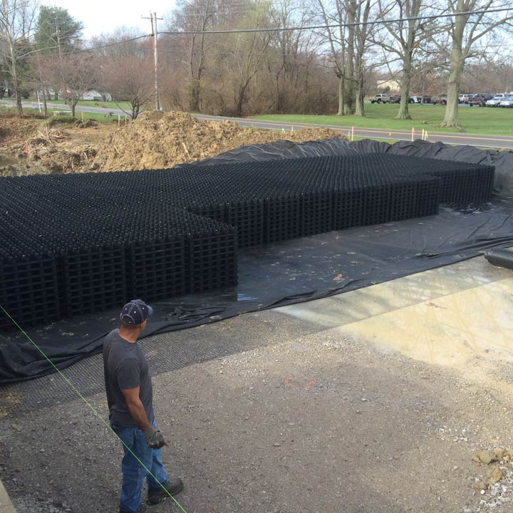 Stacked at 10 units high (1 meter / 3.28 ft), Rainstore3 was placed in the excavated area.