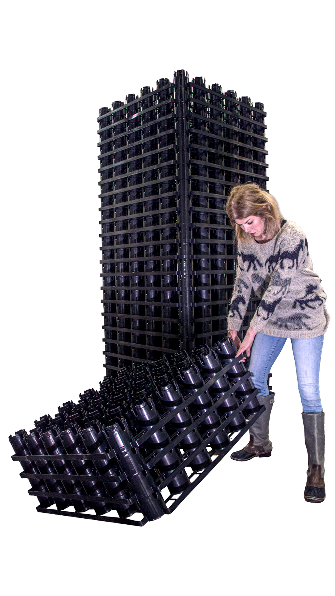 Tall stack of Rainstore 3 next to woman
