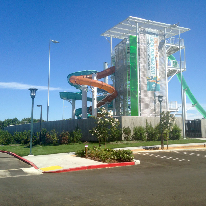 The Wave Water Park surrounded by a fire lane of grass pavers.