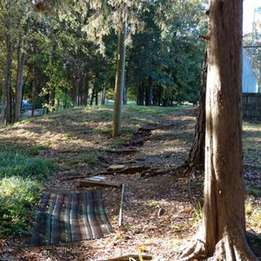 Erosion control mat for disc golf tee