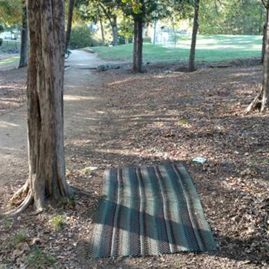 Protecting a disc golf tee pad.